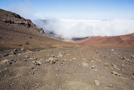 looking inside: Looking inside the Haleakala Craterwith clouds rolling in. View from the sliding sands trail