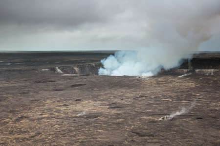 Volcanic fumes reaching for heavy skies over the Halemaâ??umaâ??u Crater in the Kilauea Caldera.