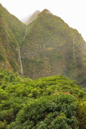 lasting: Entrance of Iao Valley. The peak are covered in almost ever lasting rain clouds. Stock Photo
