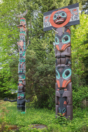 stanley: Vancouver, April 26, 2016: Two totem poles in Stanley Park. These totem poles are one of the most visited attractions. Editorial