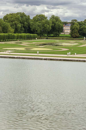 chantilly: Overview of the French garden of the Chantilly Castle Editorial