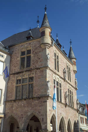 Town hall of Echternach with the flag of Luxemburg