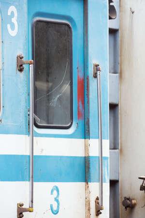 outworn: Third class train wagon with broken window