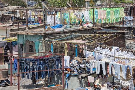 Editorial: MUMBAI, MAHARASHTRA, INDIA, April 12, 2017 - Laundry drying in the Mahalaxmi Dhobi Ghat open air laundromat in Mumbai Editorial