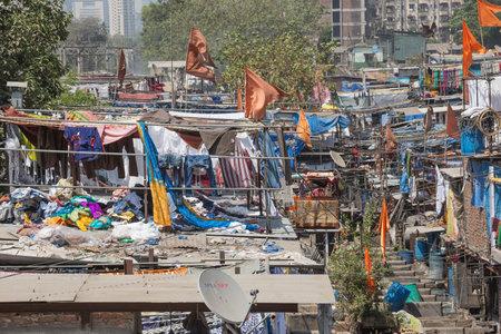 Editorial: MUMBAI, MAHARASHTRA, INDIA, April 12, 2017 - Laundry piled up on roofs in the Mahalaxmi Dhobi Ghat open air laundromat in Mumbai