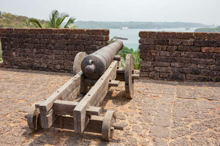 Gun overlooking the Mandovi River, at Fort Reis Magos