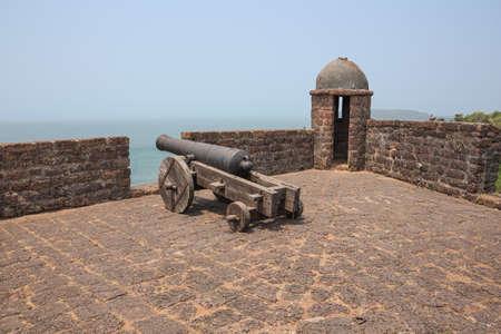 Gun and watchtower at Fort Reis Magos
