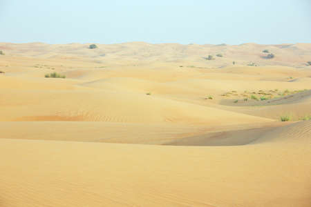 Shifting sand dunes with wind marks in the Dubai desert Stock Photo