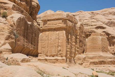 Facing giant Djinn blocks on the trail to Petra