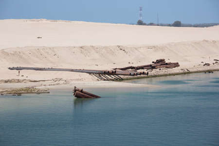 dredging: Dredging equipment on the shores of the Suez Canal near Ismailia