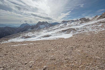 Barren landscape of gravel and snow near Zugspitzplatt