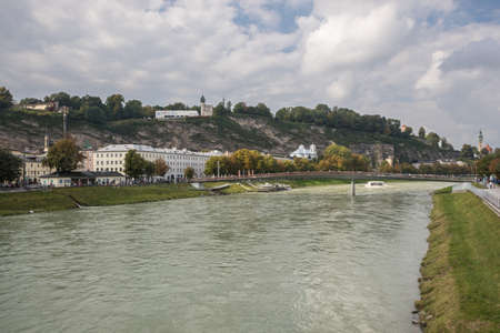 Editorial: SALZBURG, AUSTRIA, September 24, 2017 - The Makartsteg with the Monchsberg. and the Salzach River.