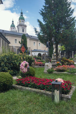 Editorial: SALZBURG, AUSTRIA, September 24, 2017 - View of St. Peters cemetery with St. Peters church in the background.