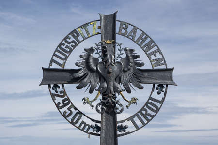 Crest emblem of the Zugspitzbahn at the Austrian side next to the Zugspitze summit station Stock Photo