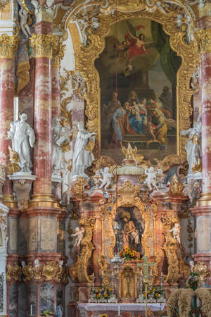 Looking at the altar of the Ettal Abbey church with rich decorations
