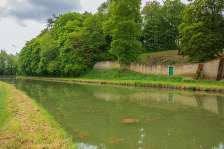 The Briare canal near Montargis with the wall of the local castle