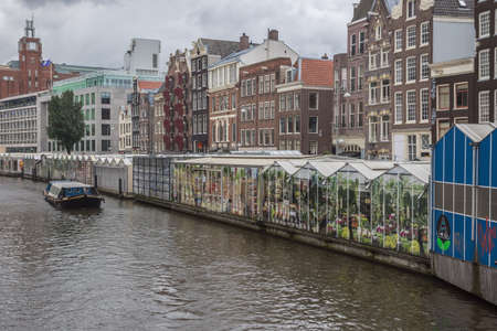 The back side of the stands of the Flower Market facing the canal