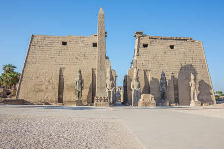 Looking into the Temple of Luxor with an obelisk and statues of Ramesses II
