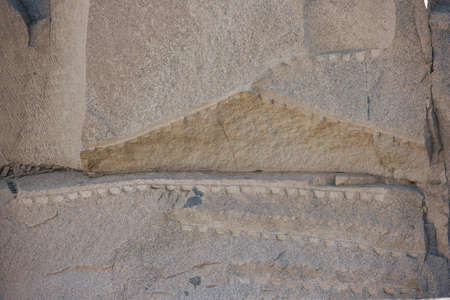 Detail of the cutting process of the unfinished obelisk of Aswan as part of a solid rock Фото со стока