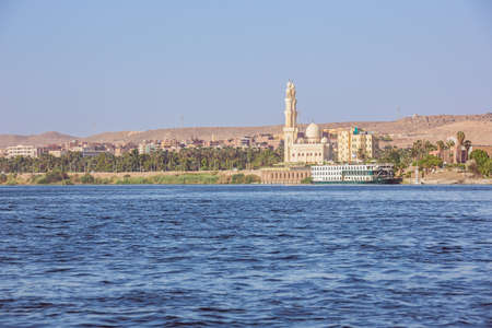 Passing Aswan by boat, navigating on the Nile