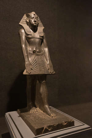 Editorial: LUXOR, EGYPT, October 16, 2018 - Close up of the statue of Amenemhat III in the Luxor museum