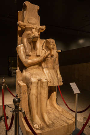 Editorial: LUXOR, EGYPT, October 16, 2018 - The statue of Amenhotep III and Sobek in the courtyard of the Luxor museum Редакционное