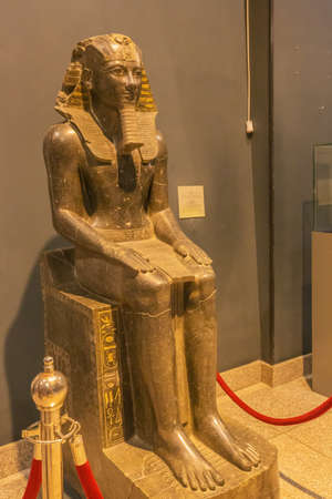 Editorial: LUXOR, EGYPT, October 16, 2018 - Statue of Thutmoses III sitting in theLuxor museum