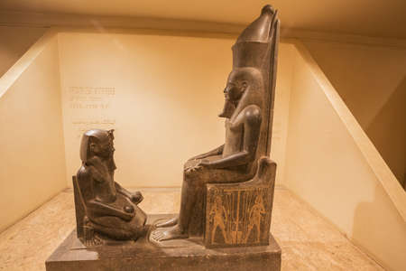 Editorial: LUXOR, EGYPT, October 16, 2018 - Statue of Horemheb kneeled before Atum in the Luxor museum Редакционное