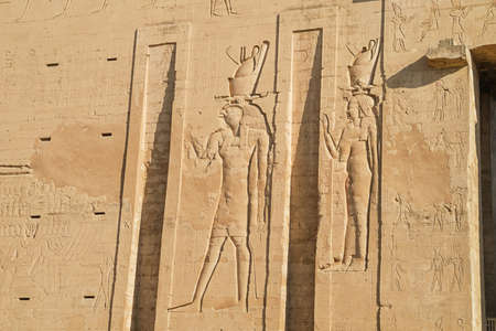 Horus and Isis at the entrance of the Temple of Horus at Edfu