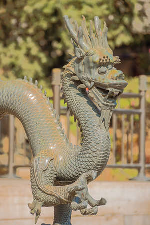 The head of a bronze dragon at the Summer Palace, the former imperial garden