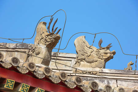 Detailed close up of Imperial roof decoration on a building in the Summer Palace, the former imperial garden