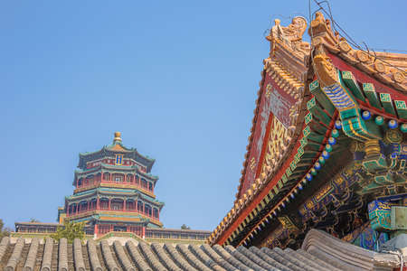 View over a rooftop of the Tower of Buddhist Incense, in the Summer Palace 写真素材