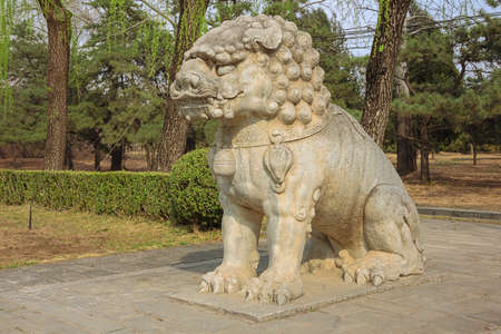 Statue of a sitting lion on the Sacred Road to the Ming Graves