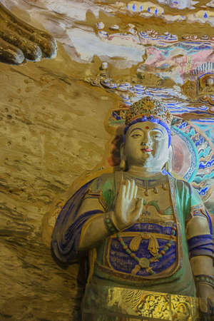 Colorful Buddha in cave 9 of the Yungang Grottoes near Datong