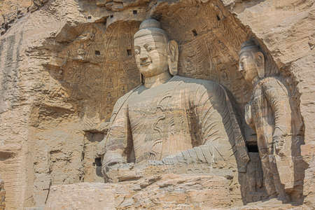 Two Buddha statues in a niche in the Yungang Grottoes near Datong
