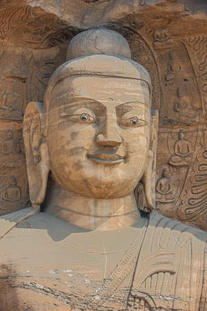 Head shot of a Buddha statue in a niche in the Yungang Grottoes near Datong