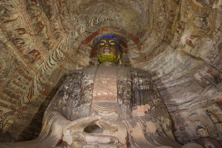 Looking up at a Buddha statue in cave 6 of the Yungang Grottoes near Datong