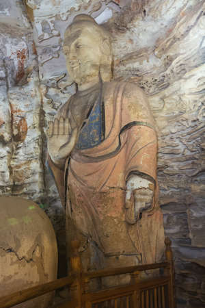 Buddha statue in cave 5 of the Yungang Grottoes near Datong