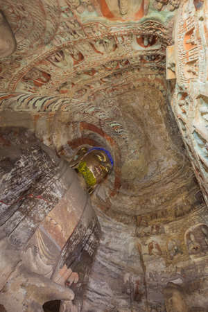 Looking at the ceiling in cave 5 of the Yungang Grottoes near Datong