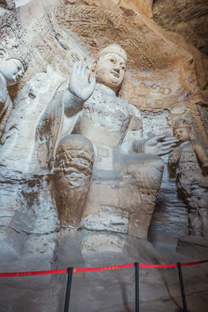 Weathered Buddha statue in cave 3 of the Yungang Grottoes near Datong