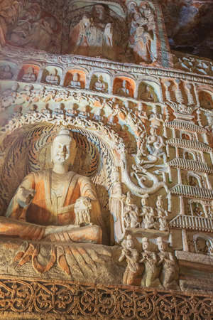 Numerous little statues with Buddha in cave 6 of the Yungang Grottoes near Datong
