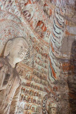 Numerous little Buddha statues in cave 5 of the Yungang Grottoes near Datong Stockfoto