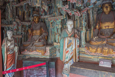 Weathered statues inside the Hanging Temple near Datong
