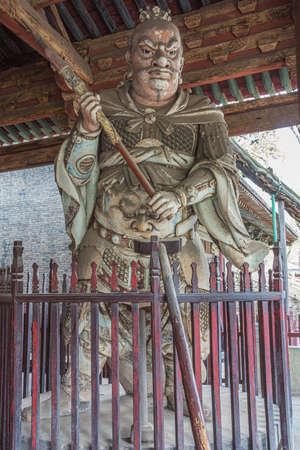 Giant wooden warrior standing guard in the Goddess Mother Hall in the Jinci temple in Taiyuan 스톡 콘텐츠
