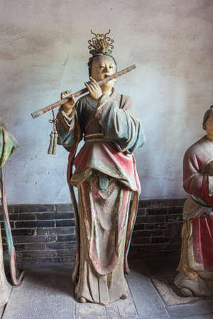 Flute playing Maidservants in the Jinci temple in Taiyuan