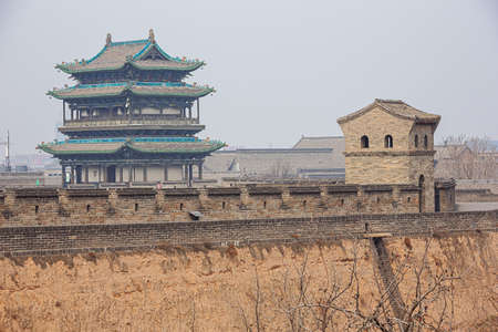 A part of the city wall and a watch tower in Pingyao seen from the city wall