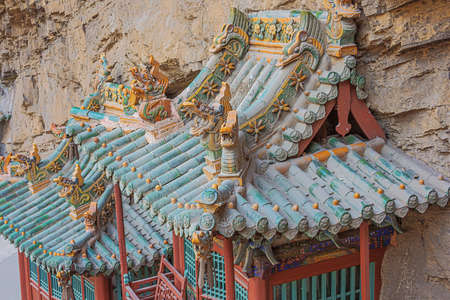 Artwork and dragons on roofs of the lower buildings of the Hanging Temple near Datong