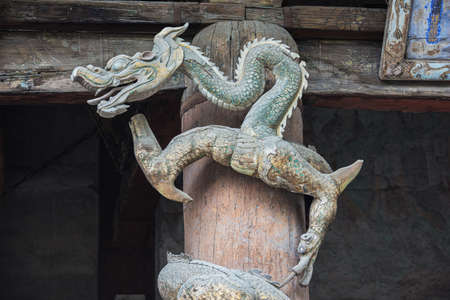 Dragon sculpture in front of the Goddess Mother Hall in the Jinci temple in Taiyuan