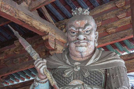 Facing a giant wooden statue in the Goddess Mother Hall in the Jinci temple in Taiyuan Reklamní fotografie