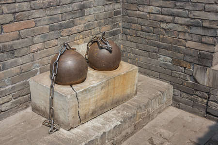 Iron spheres to restrain prisoners in the County Government Museum in Pingyao